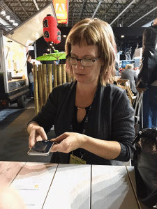 Cindy Zuelsdorf using Infusionsoft Mobile app to snap app business cards and leads into CRM at the IBC Show in Amsterdam